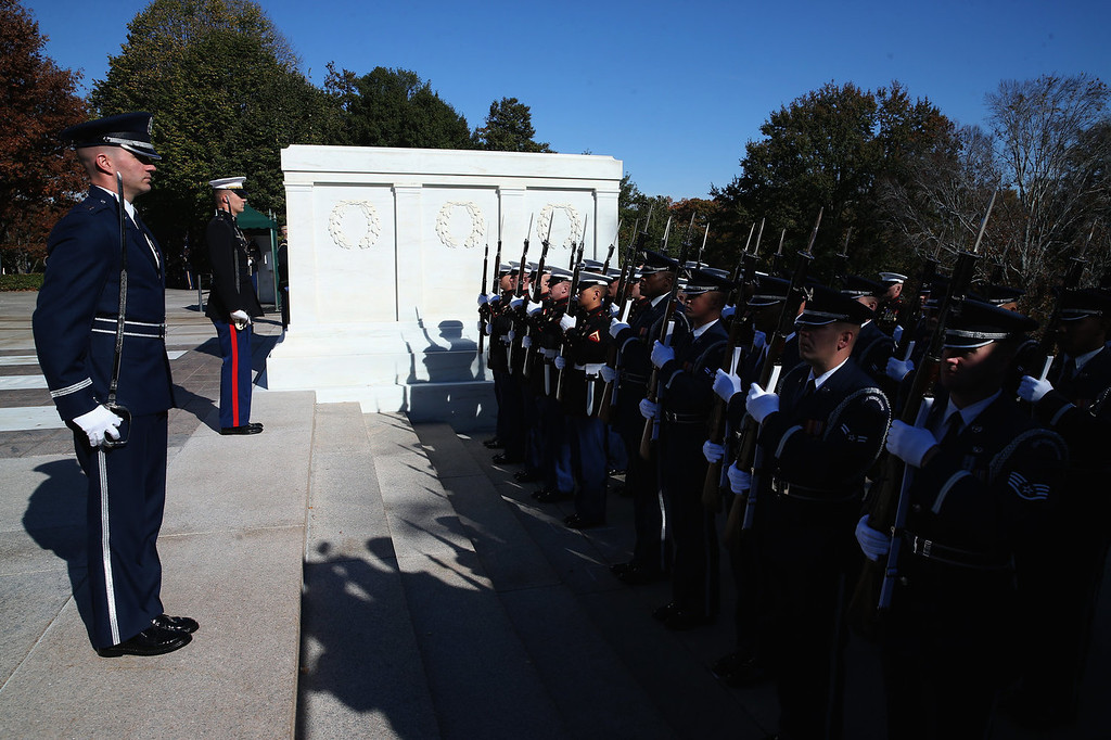 . Members of the military stand at attention before a ceremony where U.S. President Barack Obama will lay a commemorative wreath for Veterans Day at the Tomb of the Unknowns at Arlington National Cemetery on November 11, 2013 in Arlington, Virginia. For Veterans Day, President Obama is paying tribute to military veterans past and present who have served and sacrificed their lives for their country.  (Photo by Mark Wilson/Getty Images)