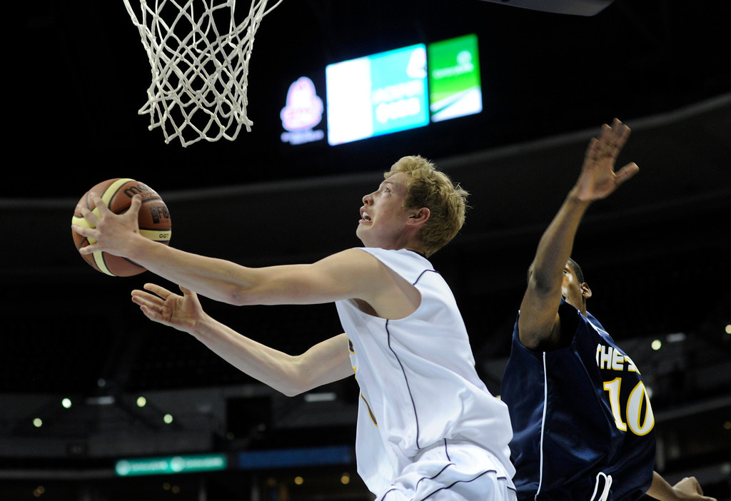 . DENVER, CO. - APRIL 6: Valor Christian junior Chase Foster (7) snuck past Overland freshman De\'Ron Davis (10) in the second half. Team Blue defeated Team White 93-77 in the annual exhibition of All-Star prep basketball talent called The Show at the Pepsi Center Saturday night, April 6, 2013. Photo By Karl Gehring/The Denver Post)