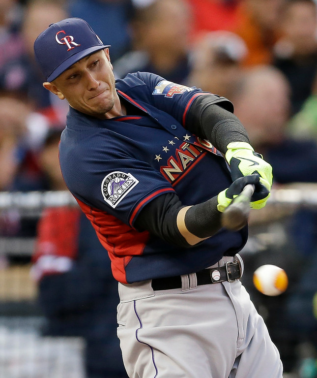 . National League\'s Troy Tulowitzki, of the Colorado Rockies, hits during the MLB All-Star baseball Home Run Derby, Monday, July 14, 2014, in Minneapolis. (AP Photo/Jeff Roberson)