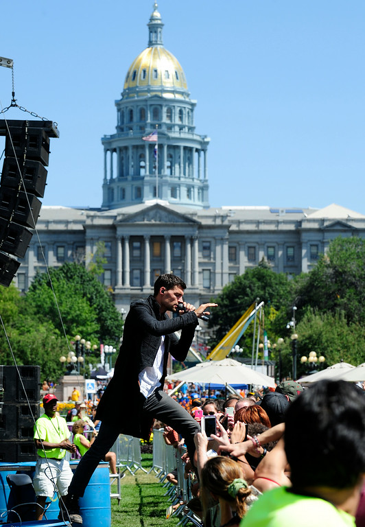 . Attendees watch the For King & Country band perform at the Access Health Colorado Main Stage during A Taste of Colorado festival at Civic Center Park in Denver, Colorado, Saturday, August 30, 2014. The free to attend festival will continue through Sunday and Monday at Civic Center Park. (Photo By Brenden Neville / Special to The Denver Post)