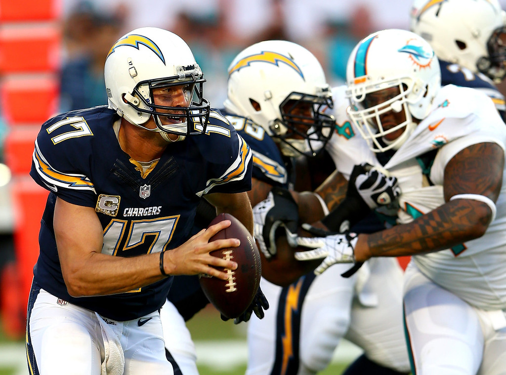 . Philip Rivers #17 of the San Diego Chargers runs with the ball during their game against the Miami Dolphins at Sun Life Stadium on November 17, 2013 in Miami Gardens, Florida.  (Photo by Streeter Lecka/Getty Images)