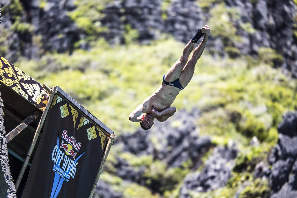 . In this handout image provided by Red Bull, David Colturi of the USA dives from the 27 meter platform at Maya Bay in the Andaman Sea during the final stop of the 2013 Red Bull Cliff Diving World Series on October 22, 2013 at Phi Phi Island, Thailand. (Photo by Dean Treml/Red Bull via Getty Images)