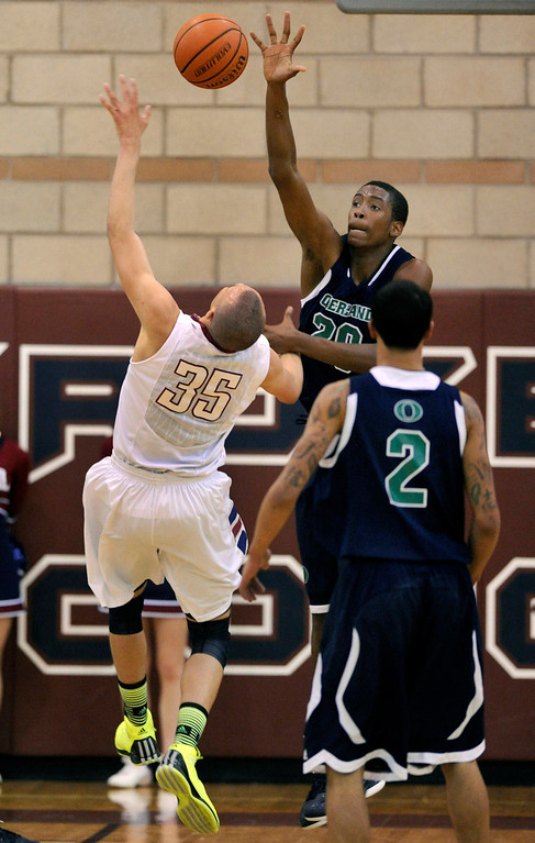 . Trailblazers center De\'Ron Davis (20) rejected an attempt by Cherokee Trail forward Drick Bernstine (35) in the first half. The Cherokee Trail boy\'s basketball team defeated Overland 59-57 Friday night, January 11, 2013. Karl Gehring/The Denver Post