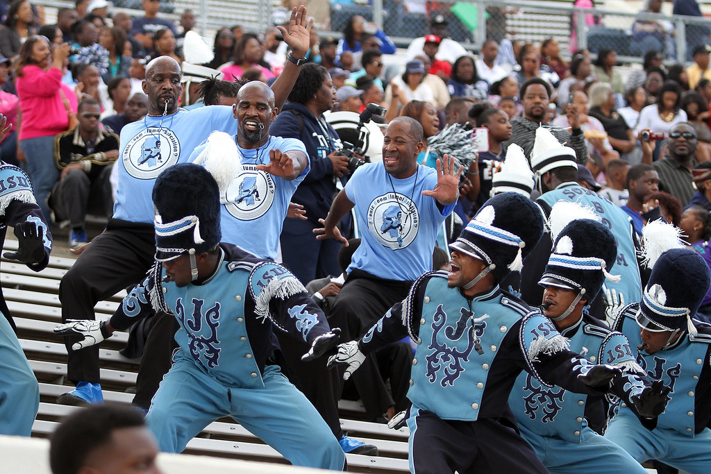 ". Jackson State ""Sonic Boom of the South\"" drum majors both past and present perform a routine prior to an NCAA college football scrimmage, Saturday, October 19, 2013 in Jackson, Miss.  Jackson State decided to continue with homecoming festivities after Saturday\'s NCAA college football game game against Grambling State was cancelled because disgruntled Grambling players refused to travel to Jackson.  (AP Photo/Charles Smith)"