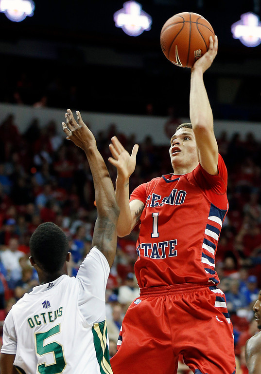 . Fresno State\'s Tyler Johnson shoots over Colorado State\'s Jonathan Octeus during the first half of a Mountain West Conference tournament NCAA college basketball game on Wednesday, March 13, 2013, in Las Vegas. (AP Photo/Isaac Brekken)