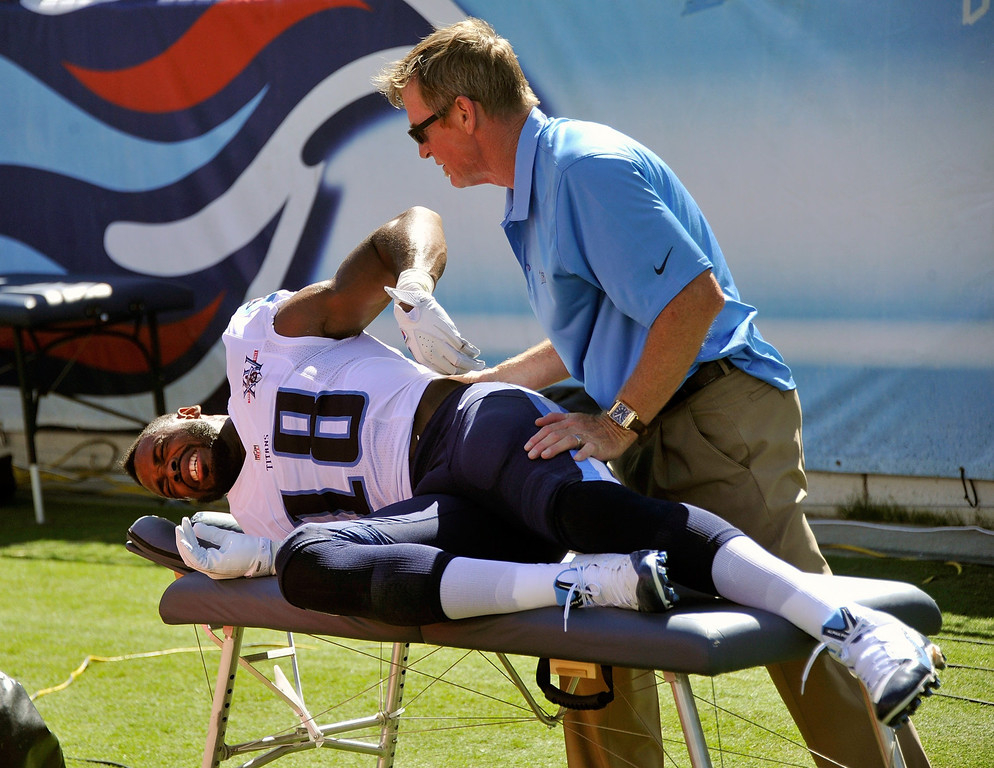 . Wide receiver Kenny Britt #18 of the Tennessee Titans is worked on by  medical staff during a game against the San Diego Chargers at LP Field on September 22, 2013 in Nashville, Tennessee.  (Photo by Frederick Breedon/Getty Images)