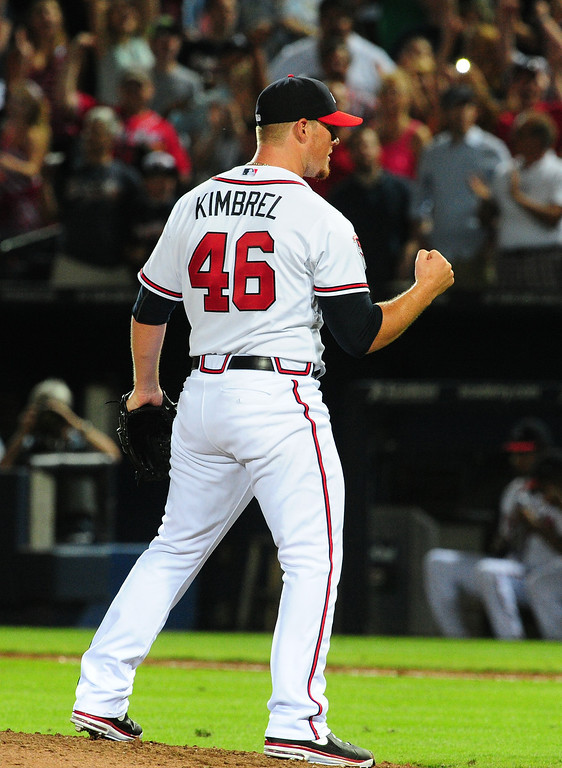 . ATLANTA, GA - MAY 23: Craig Kimbrel #46 of the Atlanta Braves reacts after striking out the side in the 9th inning for the save against the Colorado Rockies at Turner Field on May 23, 2014 in Atlanta, Georgia. (Photo by Scott Cunningham/Getty Images)