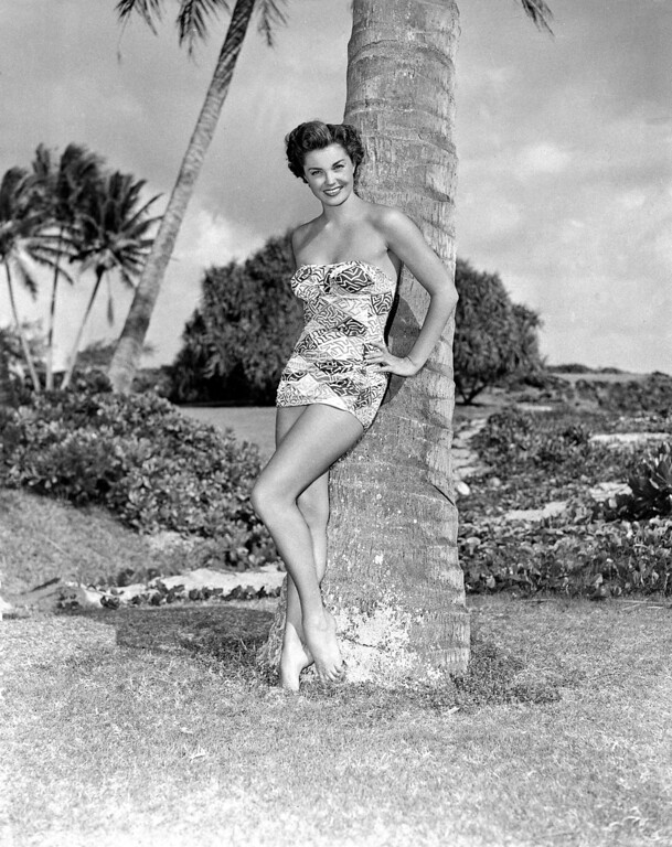 """. This April 1950 photo shows actress Esther Williams wearing a new swim suit of blue and white print by Cole of California, called \""""Cracked Ice.\""""  (AP Photo)"""