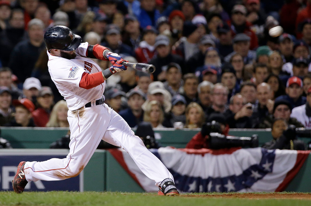 . Boston Red Sox\'s Dustin Pedroia hits a double during the fourth inning of Game 2 of baseball\'s World Series against the St. Louis Cardinals Thursday, Oct. 24, 2013, in Boston. (AP Photo/David J. Phillip)