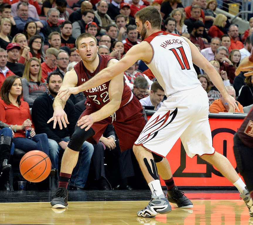 . Temple\'s Dalton Pepper passes around Louisville\'s Luke Hancock during the first half of an NCAA college basketball game, Thursday, Feb. 27, 2014, in Louisville, Ky. (AP Photo/Timothy D. Easley)