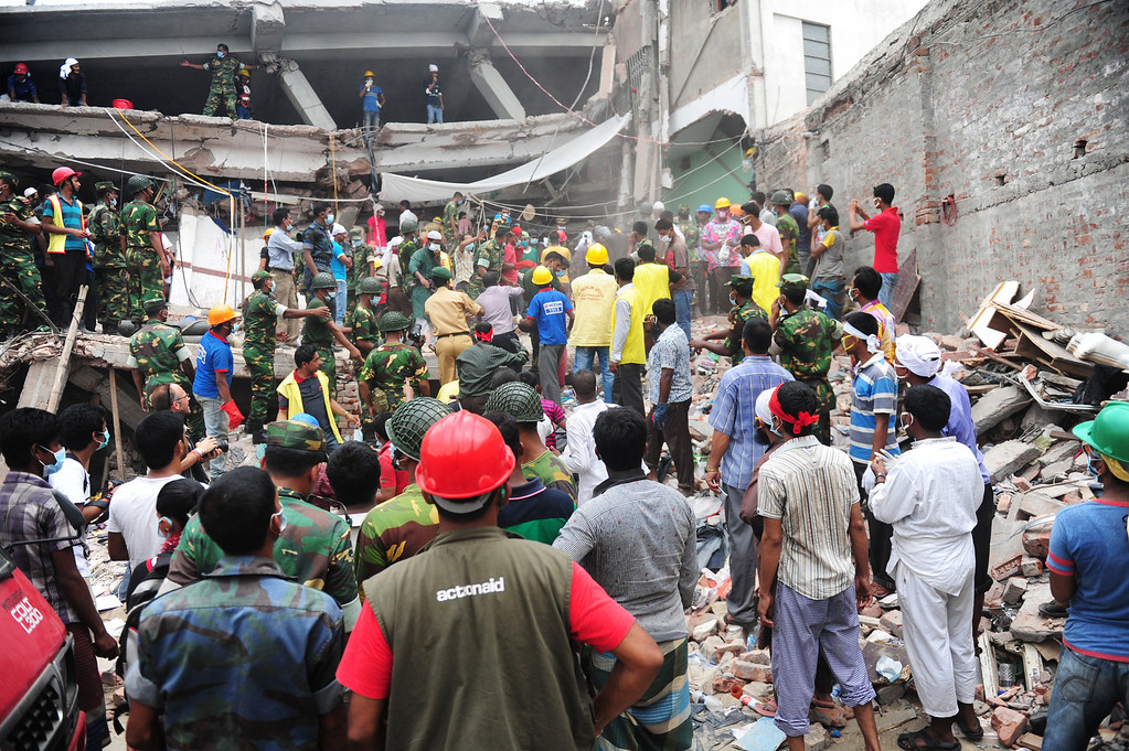 . Bangladeshi soldiers assist volunteers and rescue workers looking for survivors three days after an eight-storey building collapsed  in Savar, on the outskirts of Dhaka on April 27, 2013. Police arrested two textile bosses over a Bangladeshi factory disaster as the death toll climbed to 332 and distraught relatives lashed out at rescuers trying to detect signs of life. MUNIR UZ ZAMAN/AFP/Getty Images