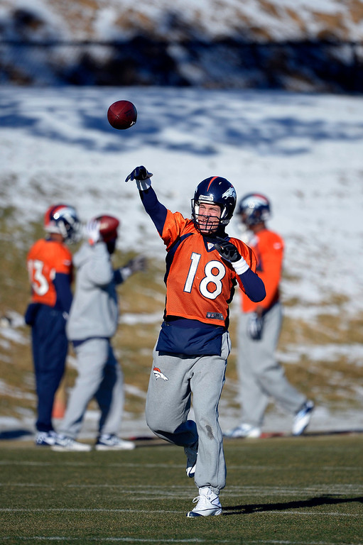 . Denver Broncos quarterback Peyton Manning (18) throws a pass during practice January 2, 2014 at Dove Valley (Photo by John Leyba/The Denver Post)