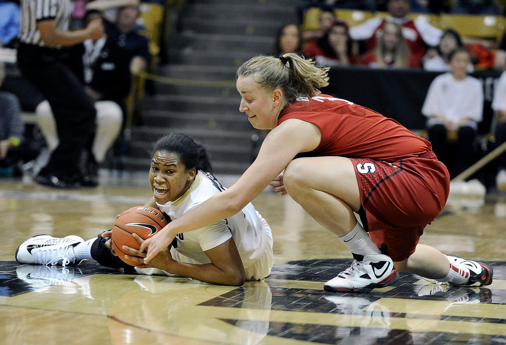 . University of Colorado\'s Ashley Wilson fights for a loose ball with Mikaela Ruef during a game against Stanford on Friday, Jan. 4, at the Coors Event Center on the CU campus in Boulder.    Jeremy Papasso/Camera