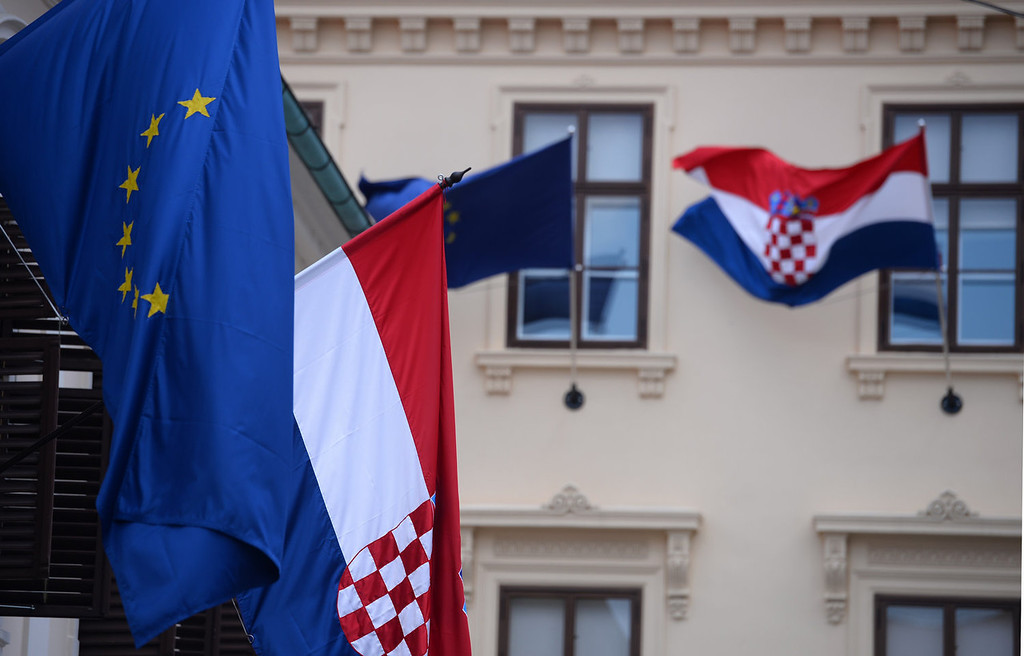 . European Union and Croatian flags are seen in downtown Zagreb on June 29, 2013. Croatia will become the 28th country to enter the European Union on July 1, 2013.    DIMITAR DILKOFF/AFP/Getty Images