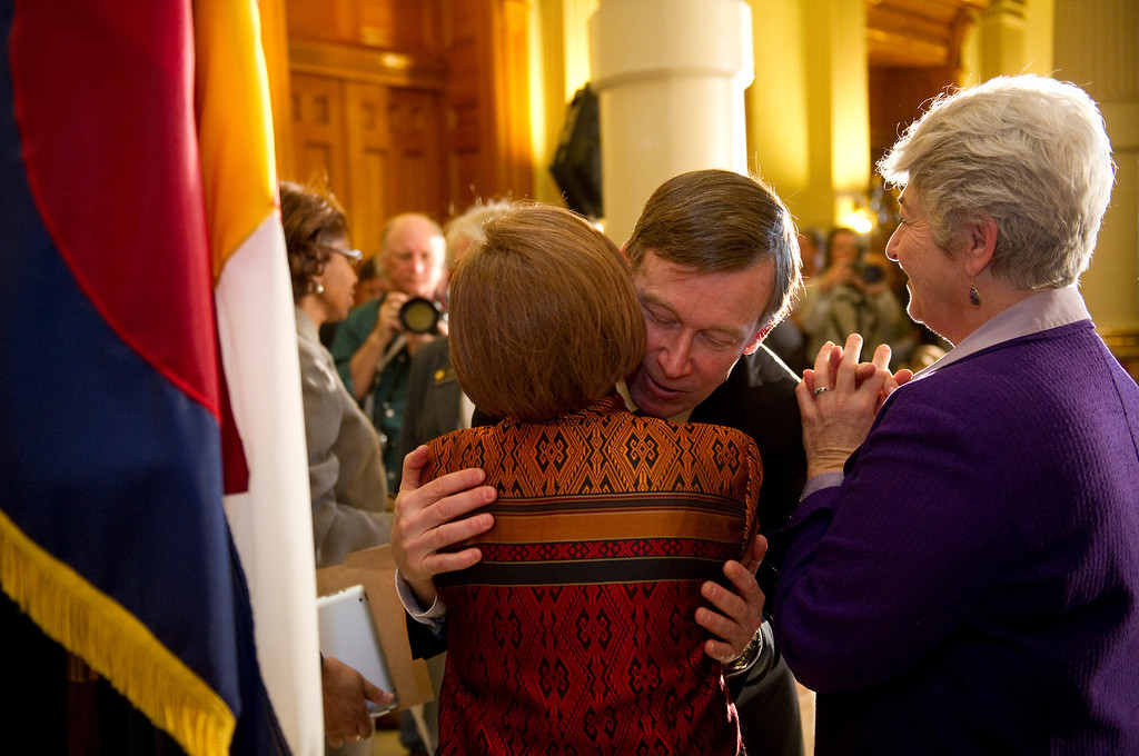 . DENVER,CO. - MARCH 20:  Governor John Hickenlooper held a press conference at the state capitol  on Wednesday, March 20, 2013 after he signed three gun bills earlier in the morning. Hickenlooper embraces   Colorado  State Representative Dickey Lee Hullinghorst, with Rep.  Lois Court, at right,  after the press conference. (Photo By Cyrus McCrimmon/The Denver Post)