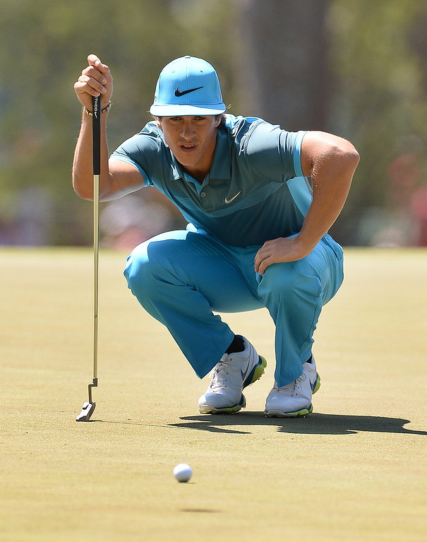 . Thorbjorn Olesen of Denmark lines a putt on the 3rd green during the third round of the 78th Masters Golf Tournament at Augusta National Golf Club on April 12, 2014 in Augusta, Georgia.   EMMANUEL DUNAND/AFP/Getty Images