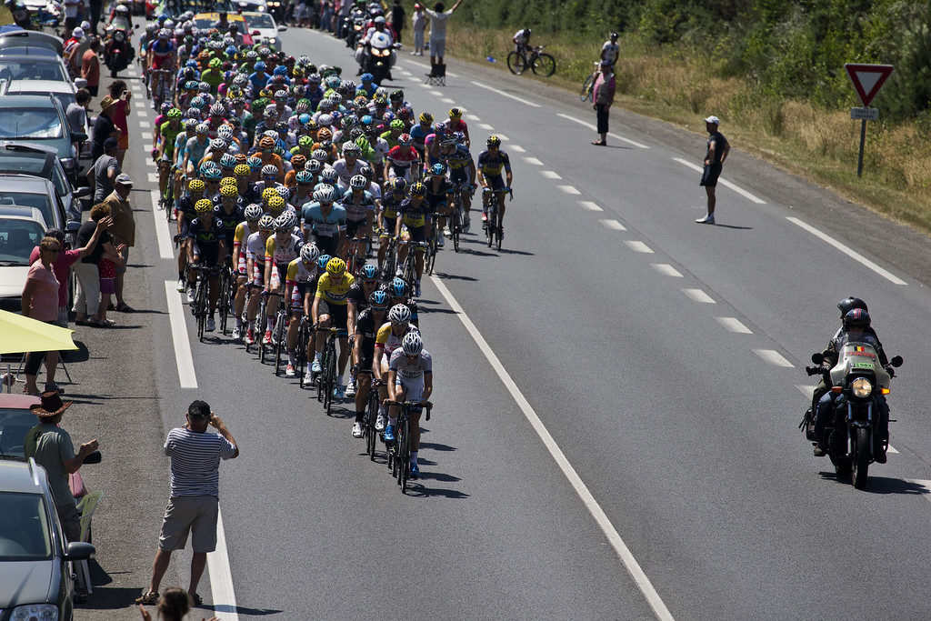 . The pack rides during the 197 km tenth stage of the 100th edition of the Tour de France cycling race on July 9, 2013 between Saint-Gildas-des-Bois and Saint-Malo, northwestern France.     JOEL SAGET/AFP/Getty Images