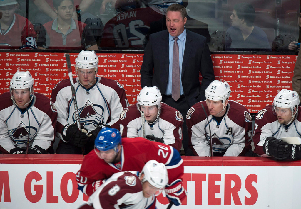 . Colorado Avalanche coach Patrick Roy yells out from behind the bench as his team faces the Montreal Canadiens during first period NHL hockey action Tuesday, March 18, 2014 in Montreal. (AP Photo/The Canadian Press, Paul Chiasson)
