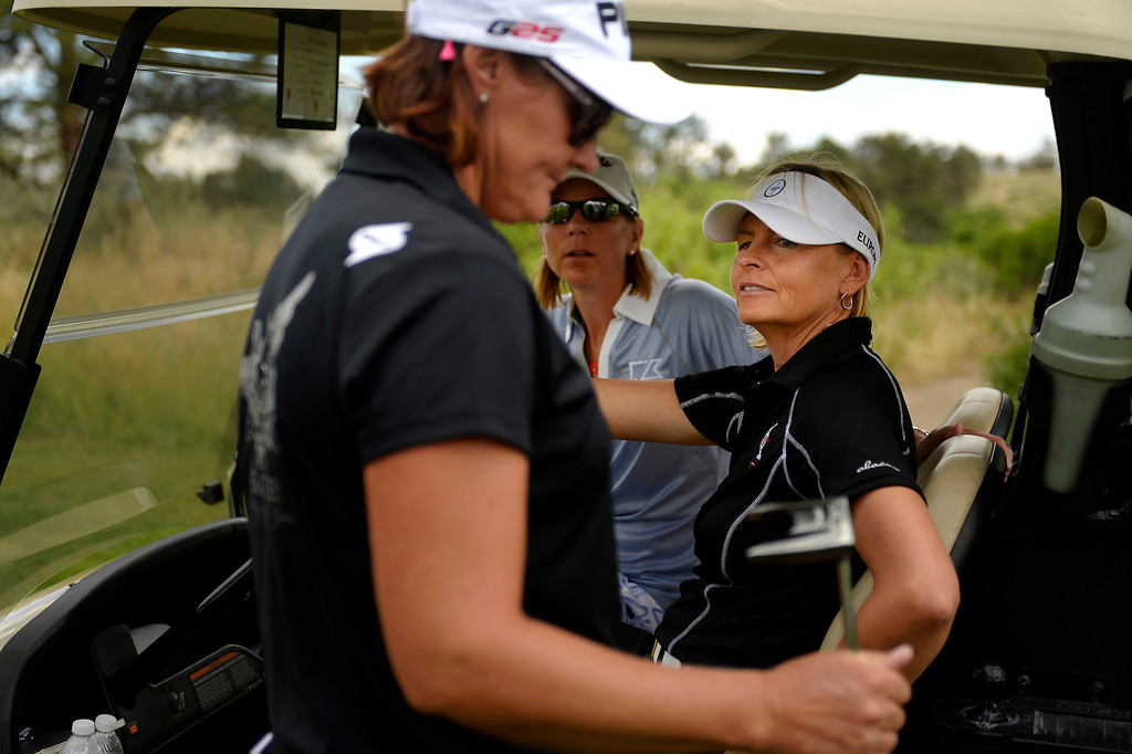 . Maria Hjorth, representing Sweden, listens to vice captain Annika Sorenstam and captain Liselotte Neumann of the 2013 European Solheim Cup Team on the course as they take a look at Colorado Golf Club in Parker, Colorado. (Photo By Joe Amon/The Denver Post)