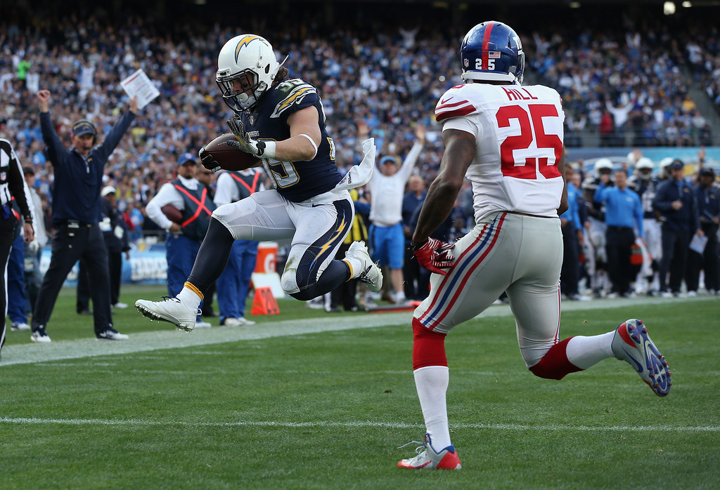 . SAN DIEGO, CA - DECEMBER 08:  Running back Danny Woodhead #39 of the San Diego Chargers jumps into the end zone past free safety Will Hill #25 of the New York Giants for a touchdown in the first half at Qualcomm Stadium on December 8, 2013 in San Diego, California.  (Photo by Jeff Gross/Getty Images)