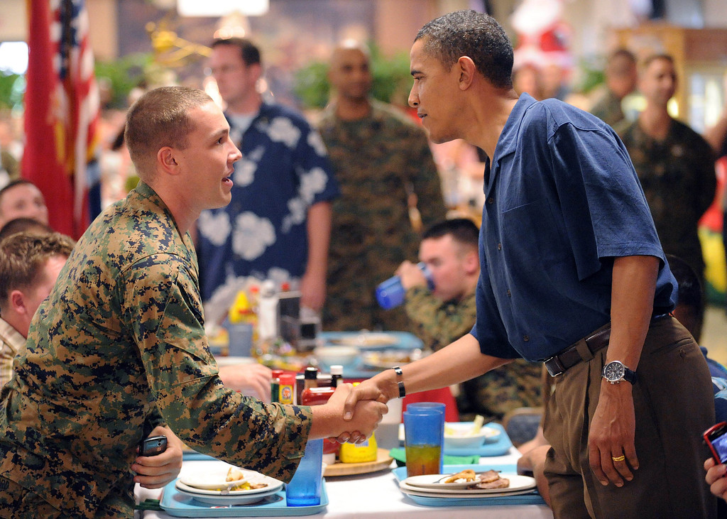 . US President-elect Barack Obama (R) shakes hands with Marines having Christmas dinner December 25, 2008 at Marine Corps Base Hawaii in Kailua, Hawaii.     TIM SLOAN/AFP/Getty Images