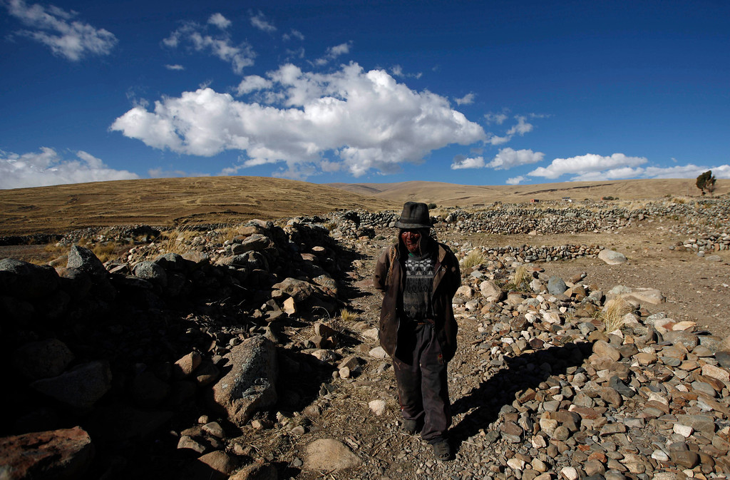 . Carmelo Flores Laura, a native Aymara, walks near his home in the village of Frasquia, Bolivia, Tuesday, Aug. 13, 2013. If Bolivia�s public records are correct, Flores is the oldest living person ever documented. They say he turned 123 a month ago. To what does the cattle and sheepherder owe his longevity? �I walk a lot, that�s all. I go out with the animals,� he says.  (AP Photo/Juan Karita)