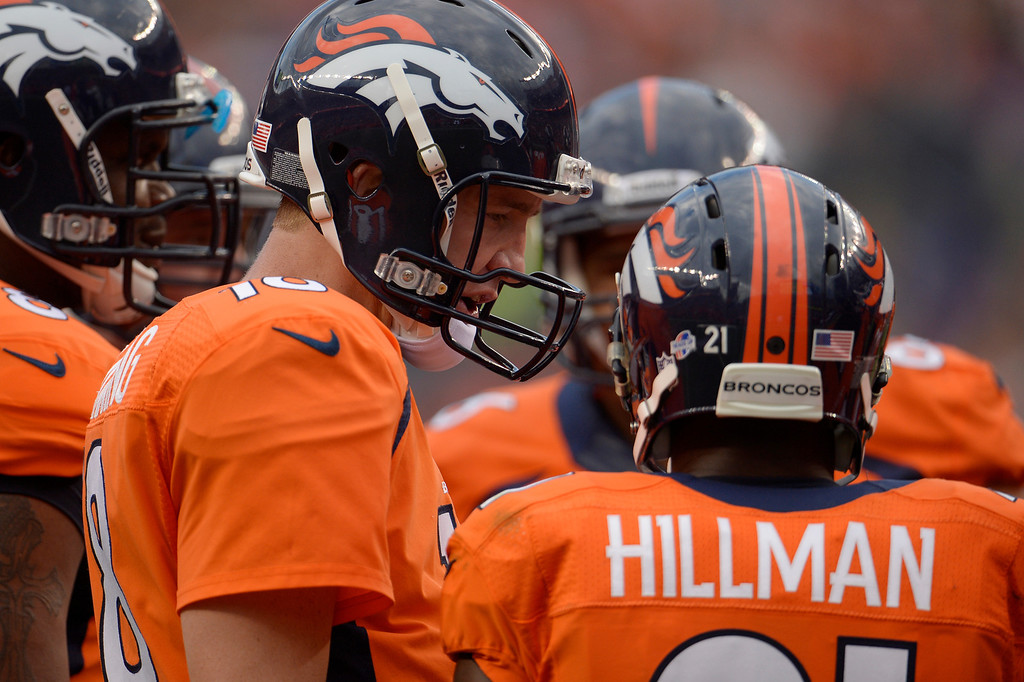 . DENVER, CO. - August 24: Quarterback Peyton Manning (18) of the Denver Broncos speaks with running back Ronnie Hillman (21) of the Denver Broncos in the huddle during the first half of action. The Denver Broncos vs the St. Louis Rams during the 3rd pre-season game of the season at Sports Authority Field at Mile High. August 24, 2013 Denver, Colorado. (Photo By Joe Amon/The Denver Post)
