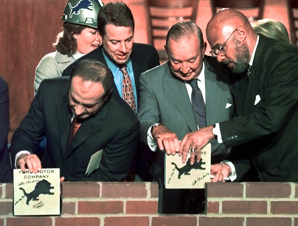 . Ceremonial bricks are placed at the groundbreaking ceremony for Ford Field, the new home of the Detroit Lions in downtown Detroit, Tuesday, Nov. 16, 1999.  Pictured are, from left: Ford Motor Co. President and CEO Jacques Nasser, Detroit Lions Vice Chairman William Clay Ford Jr., Detroit Lions Chairman and President William Clay Sr., and Detroit Mayor Dennis Archer. It is  expected to be completed by July 1, 2002.   (AP Photo/Paul Sancya)