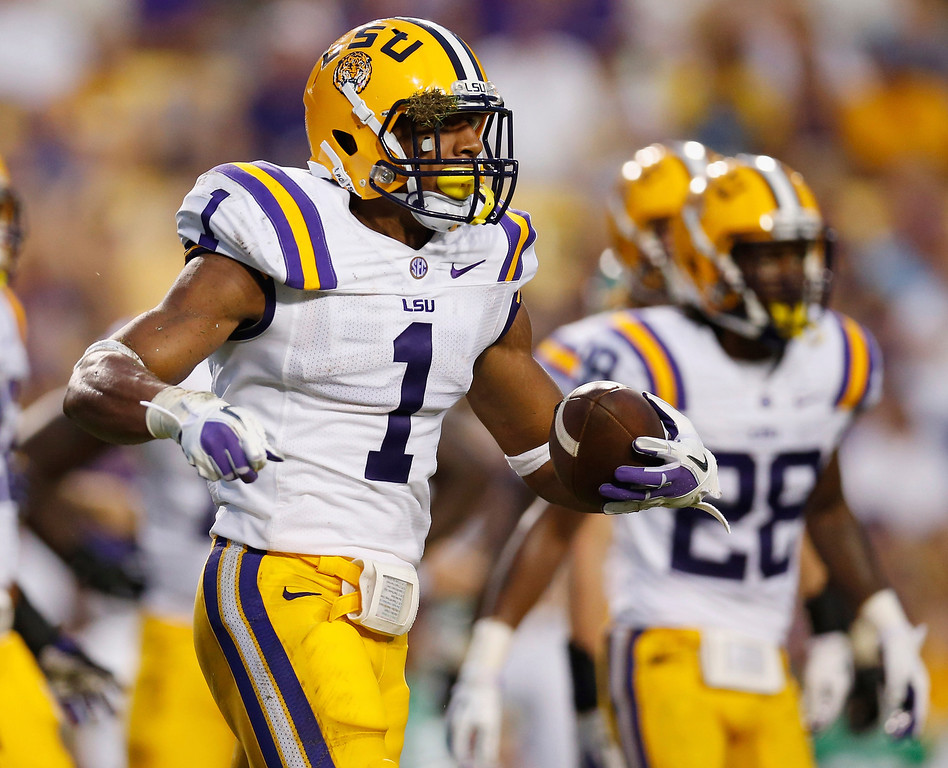 . Eric Reid #1 of the LSU Tigers reacts after intercepting the ball against the North Texas Mean Green at Tiger Stadium on September 1, 2012 in Baton Rouge, Louisiana.  (Photo by Chris Graythen/Getty Images)