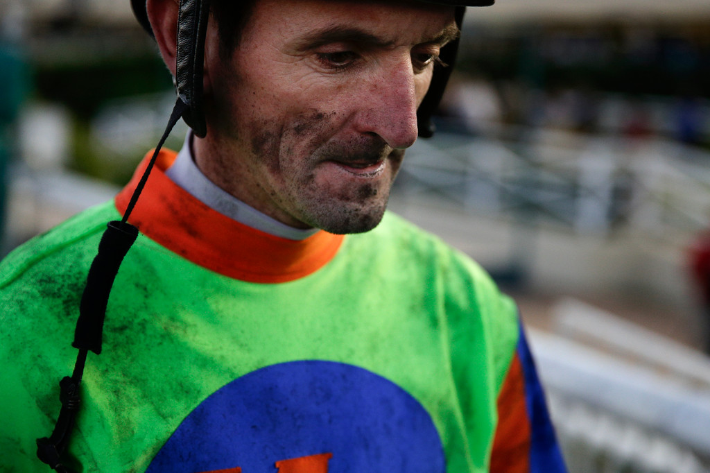 . Jockey Robby Albarado walks off the track after a horse race at Betfair Hollywood Park on Saturday, Dec. 14, 2013, in Inglewood, Calif. After 75 years of thoroughbred racing, Betfair Hollywood Park is closing for good. The 260-acre track that hosted Seabiscuit and the first Breeders\' Cup in 1984 will be turned into a housing and retail development starting next year. (AP Photo/Jae C. Hong)