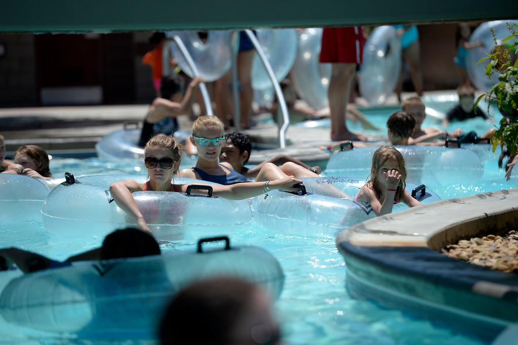. Families take in a day to cool off as they ride on the lazy river at Pirates Cove July 17, 2013.  (Photo By John Leyba/The Denver Post)