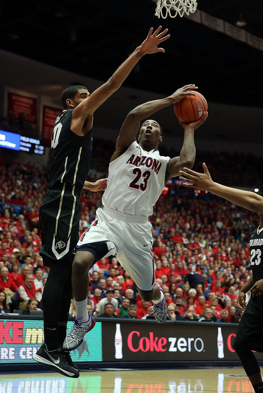 . Rondae Hollis-Jefferson #23 of the Arizona Wildcats attempts a shot against the Colorado Buffaloes during the first half of the college basketball game at McKale Center on January 23, 2014 in Tucson, Arizona.  (Photo by Christian Petersen/Getty Images)