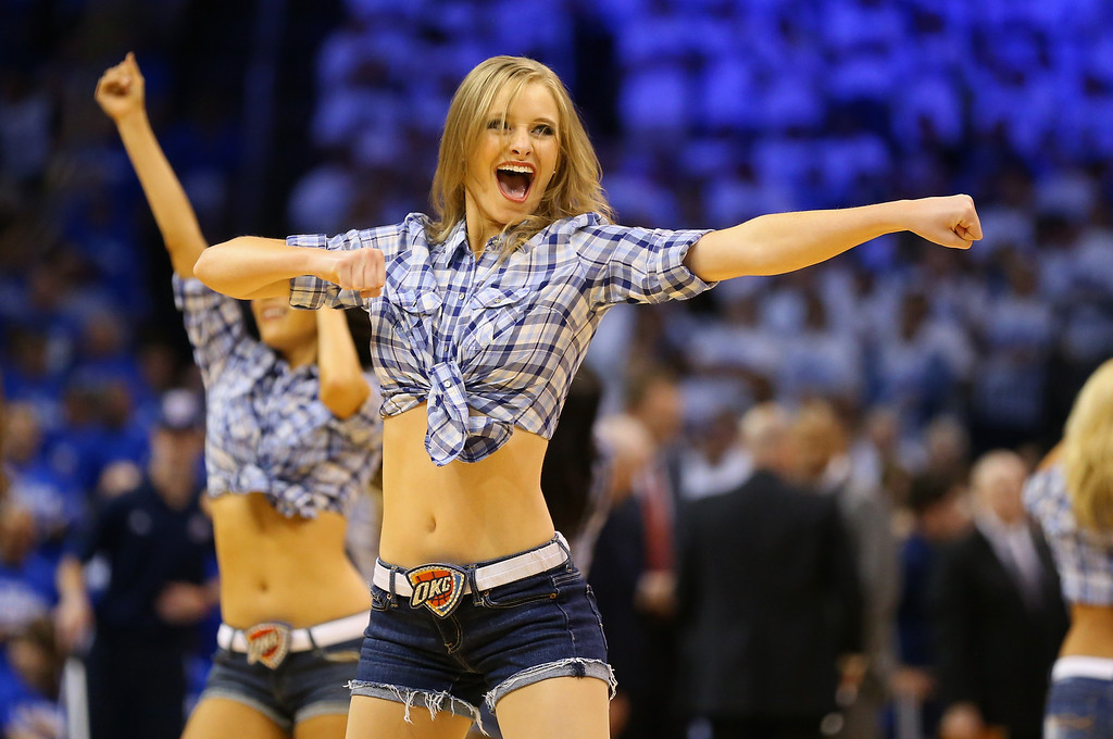. OKLAHOMA CITY, OK - MAY 27: An Oklahoma City Thunder dancer performs in the first quarter against the San Antonio Spurs during Game Four of the Western Conference Finals of the 2014 NBA Playoffs at Chesapeake Energy Arena on May 27, 2014 in Oklahoma City, Oklahoma. (Photo by Ronald Martinez/Getty Images)
