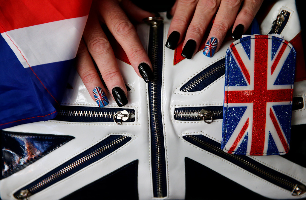 . Fan Denise Walker shows her Union Jack painted nails before the start of the women\'s bobsled competition at the 2014 Winter Olympics, Wednesday, Feb. 19, 2014, in Krasnaya Polyana, Russia. (AP Photo/Jae C. Hong)