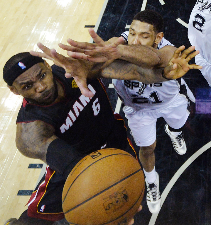 . Miami Heat forward LeBron James (6) shoots as San Antonio Spurs forward Tim Duncan (21) defends during the first half in Game 5 of the NBA basketball finals on Sunday, June 15, 2014, in San Antonio. (AP Photo/Bob Donnan, pool)