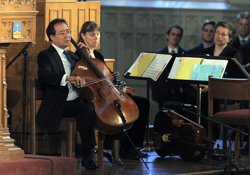""". Musician Yo-Yo Ma performs during \""""Healing Our City: An Interfaith Service\"""" dedicated to those who were gravely wounded or killed in the Boston Marathon bombing, at the Cathedral of the Holy Cross in Boston, Massachusetts, on April 18, 2013. AFP PHOTO/Jewel  SAMAD/AFP/Getty Images"""