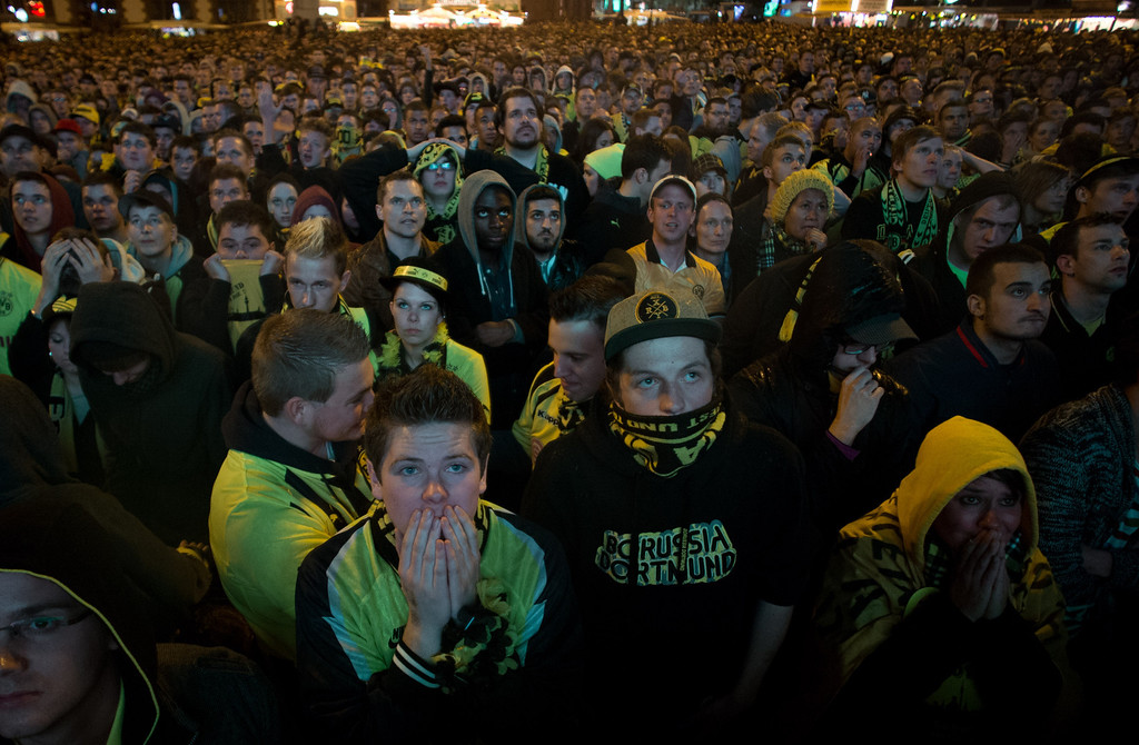 . Supporters of German first division football club Borussia Dortmund attending a public viewing event in Dortmund, western Germany, react on May 25, 2013, after the UEFA Champions League final of Borussia Dortmund vs Bayern Munich taking place at Wembley. Fan zones in both Munich and Dortmund will be full, while Berlin\'s iconic Brandenburg Gate will show the game on a giant screen. JOHANNES EISELE/AFP/Getty Images