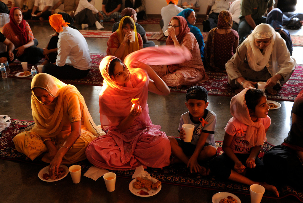 . People of all faiths were invited to share in a prayer vigil and dinner meal at the Sikh temple in Commerce City on Wednesday, August 8, 2012.  Six members of the Sikh faith who were recently in Wisconsin were remembered in a candlelight vigil following the meal. Karl Gehring, The Denver Post