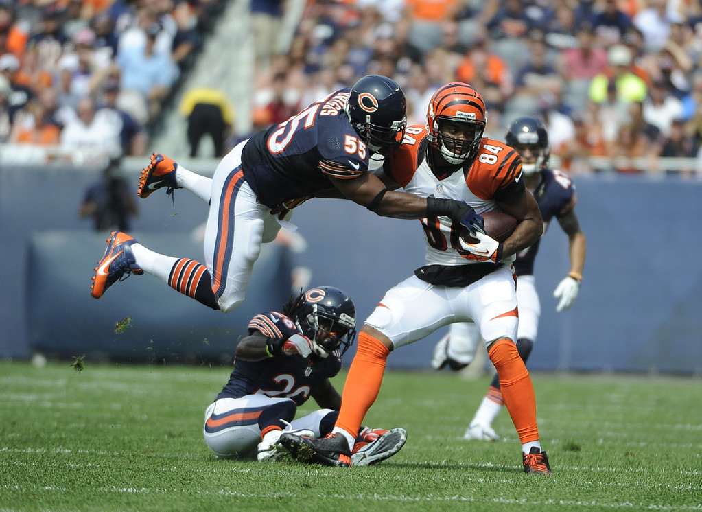 . Lance Briggs #55 of the Chicago Bears tackles Jermaine Gresham #84 of the Cincinnati Bengals during the first half on September 8, 2013 at Soldier Field in Chicago, Illinois. (Photo by David Banks/Getty Images)