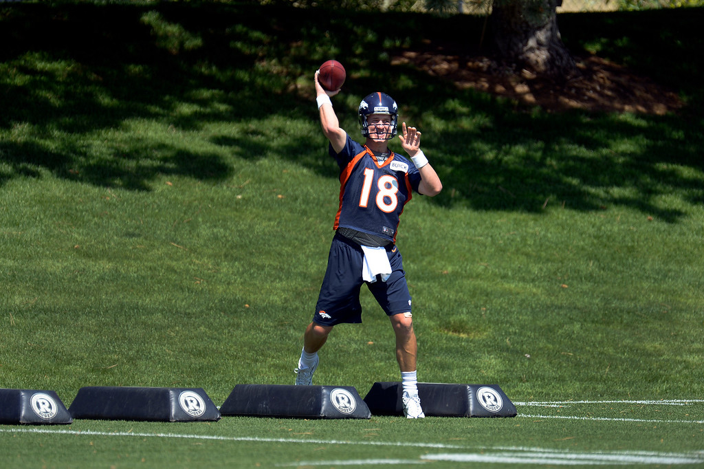 . Peyton Manning (18) quarterback of the Denver Broncos works on drills during mini camp June 11, 2013 at Dove Valley. (Photo By John Leyba/The Denver Post)