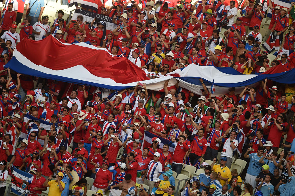 . Fans of Costa Rica cheer before a Group D football match between Uruguay and Costa Rica at the Castelao Stadium in Fortaleza during the 2014 FIFA World Cup on June 14, 2014.  AFP PHOTO / CHRISTOPHE SIMON