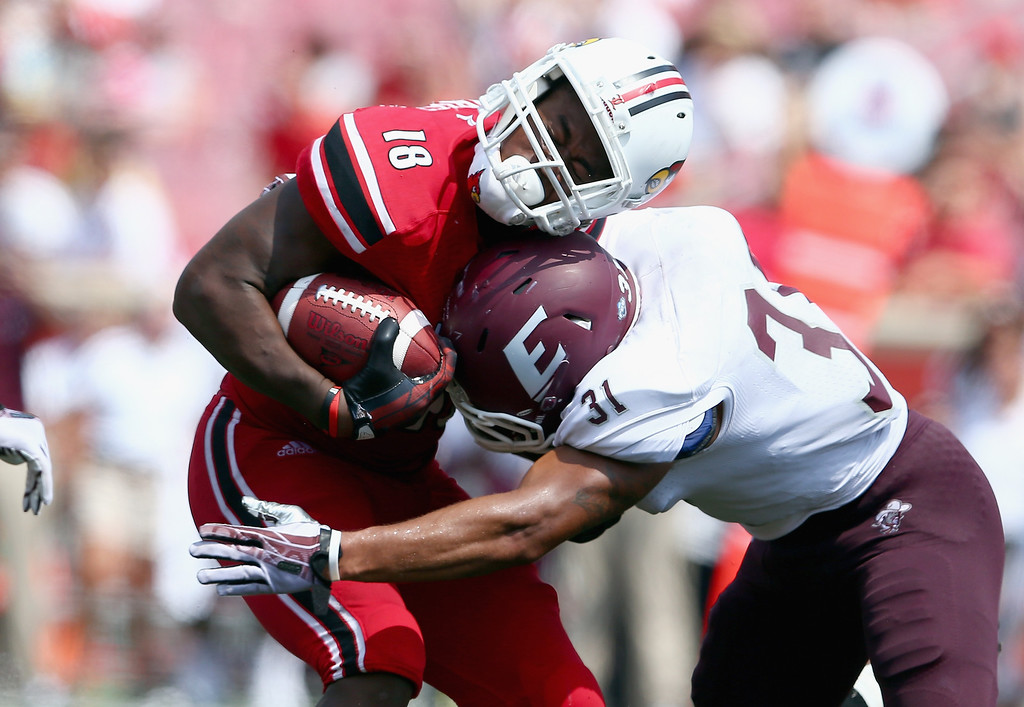 . LOUISVILLE, KY - SEPTEMBER 07:  Gerald Christian #18 of the Louisville Cardinals collides with Christian Albertson #31 of the Eastern Kentucky Colonels during the game at Papa John\'s Cardinal Stadium on September 7, 2013 in Louisville, Kentucky.  (Photo by Andy Lyons/Getty Images)