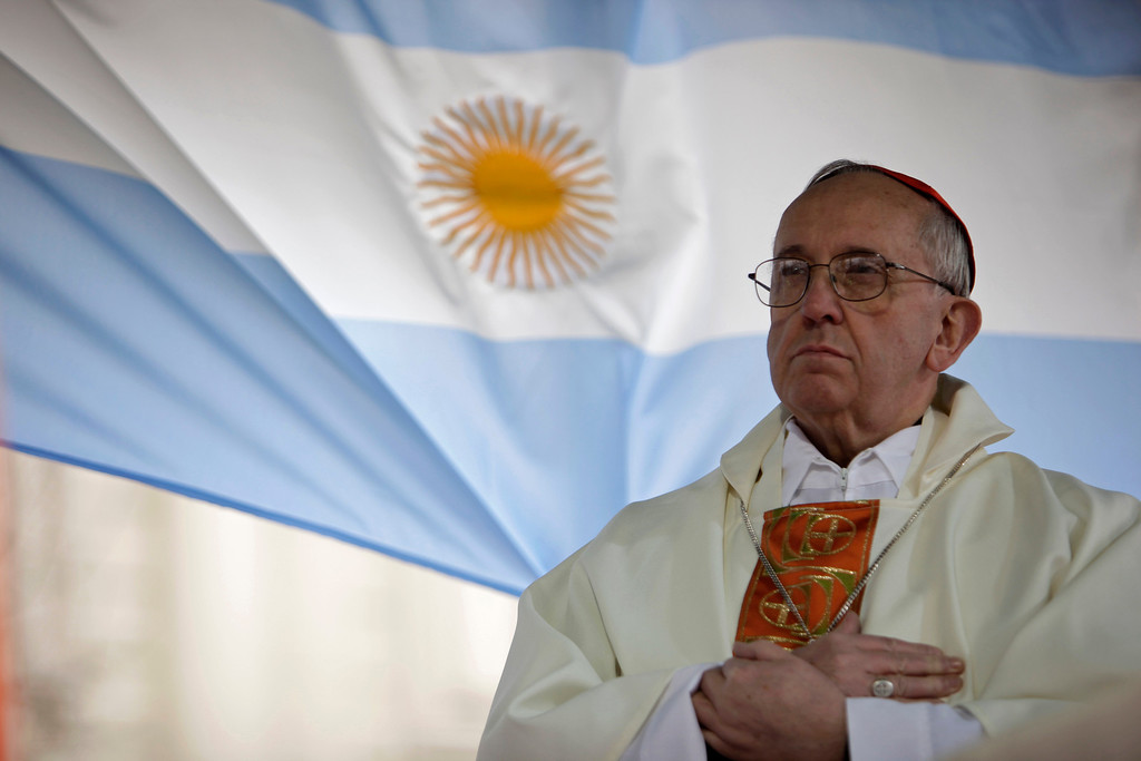 . This Aug. 7, 2009 file photo shows Argentina\'s Cardinal Jorge Bergoglio giving a mass outside the San Cayetano church in Buenos Aires. Bergoglio, who took the name of Pope Francis,  was elected on Wednesday, March 13, 2013 the 266th pontiff of the Roman Catholic Church.  (AP Photo/Natacha Pisarenko, files)