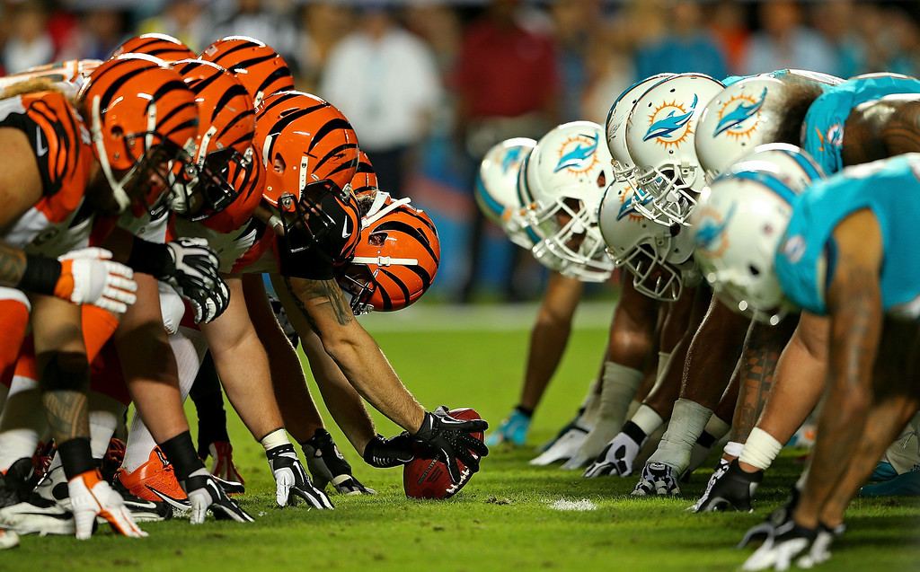 . MIAMI GARDENS, FL - OCTOBER 31: The Cincinnati Bengals snap the ball against the Miami Dolphins during a game  at Sun Life Stadium on October 31, 2013 in Miami Gardens, Florida.  (Photo by Mike Ehrmann/Getty Images)
