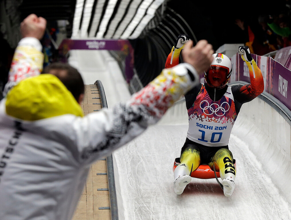 . Felix Loch of Germany celebrates as he crosses the finish area to win the gold medal during the men\'s singles luge final at the 2014 Winter Olympics, Sunday, Feb. 9, 2014, in Krasnaya Polyana, Russia.  (AP Photo/David J. Phillip )