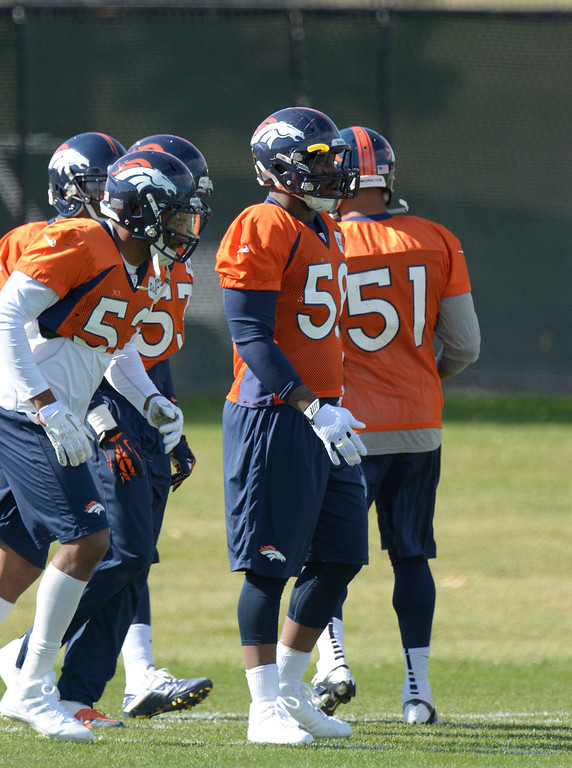 . Denver Broncos outside linebacker Von Miller (58) runs through drills during his first day back to practice October 16, 2013 at Dove Valley. Miller just finished serving a six game suspension. (Photo by John Leyba/The Denver Post)