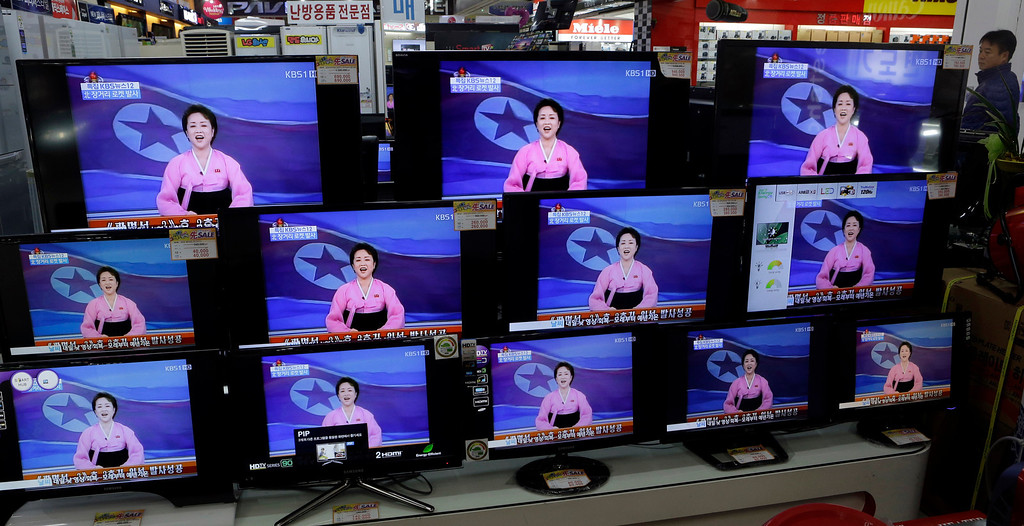. A man watches TV screen showing a North Korean TV anchorwoman announcing the success of a rocket launch, at an electronic shop in Seoul, South Korea, Wednesday, Dec. 12, 2012. North Korea successfully fired a long-range rocket on Wednesday, defying international warnings as the regime of Kim Jong Un took a giant step forward in its quest to develop the technology to deliver a nuclear warhead. (AP Photo/Lee Jin-man)