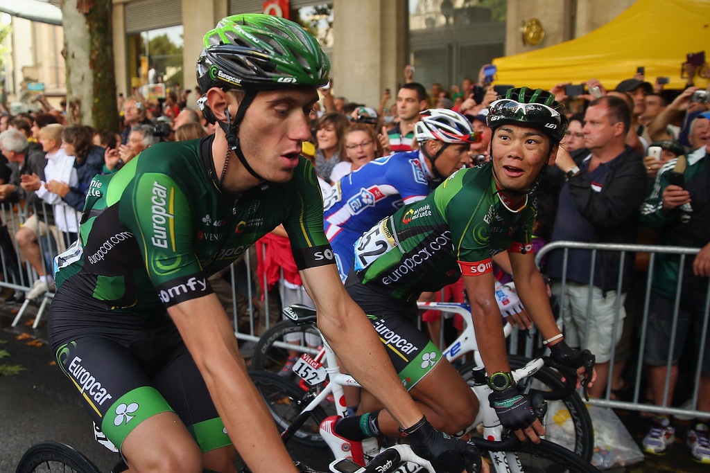 . Yukiya Arashiro of Japoan and Team Europcar finishes the fifteenth stage of the 2014 Tour de France, a 222km stage between Tallard and Nimes, on July 20, 2014 in Nimes, France.  (Photo by Bryn Lennon/Getty Images)