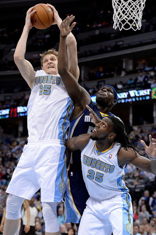 . Denver Nuggets center Timofey Mozgov (25) grabs a rebound over Memphis Grizzlies forward Zach Randolph (50) as forward Kenneth Faried (35) boxes out during the second quarter. (Photo by AAron Ontiveroz/The Denver Post)