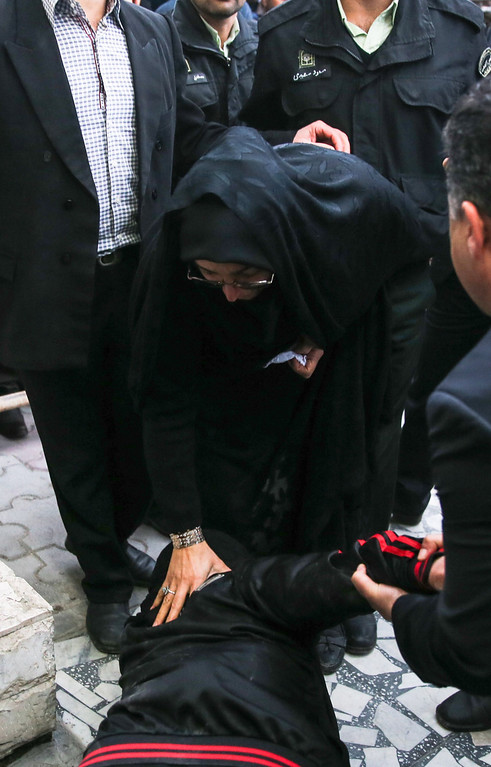 . The mother of Iranian national Balal (bottom), who killed fellow Iranian youth Abdolah Hosseinzadeh in a street fight with a knife in 2007, kisses the feet of Samereh Alinejad (C), the mother of Abdolah, after her son was pardoned by the parents of the victim during his execution ceremony in the northern city of Nowshahr on April 15, 2014.  AFP PHOTO/ARASH KHAMOOSHI/AFP/Getty Images